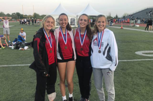 Girls track team with medals